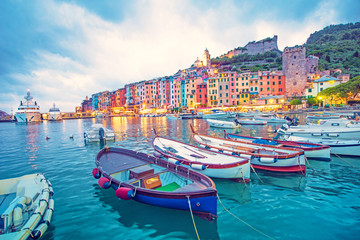 Stores photo Bleu jean Mystic landscape of the harbor with colorful houses and the boats in Porto Venero, Italy, Liguria in the evening in the light of lanterns