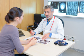 Doctor discussing xray results with patient