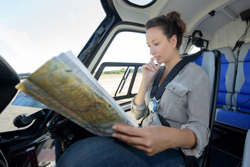 female traveler looking into the tourist map