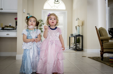 Sisters in dress standing at home