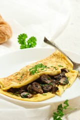 Homemade fluffy Mushroom Omelette garnished with Chives , selective focus