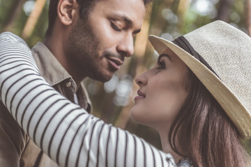 Young man and woman want kiss each other. They are standing close in pleasant embrace. Male eyes are closed