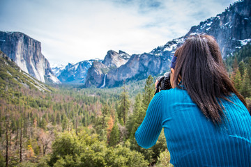 Taking a picture of the snow capped mountains at Tunnel View Yosemite National Park