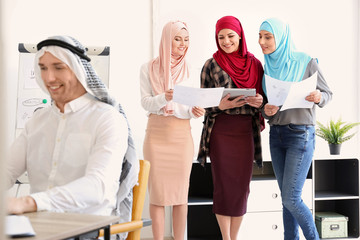 Muslim businesswomen in traditional clothes at workplace