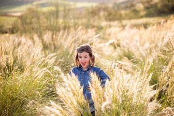 little girl posing in the field