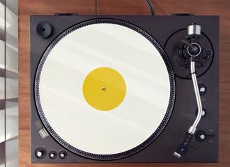 Vintage Record Turntable Player With White Vinyl Disk