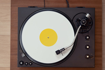 Vintage Record Turntable Plays White Vinyl Disk