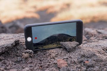 Close up screen of smartphone device shots time lapse video with landscape travel and smartphone concept