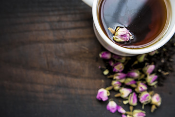 cup with tea rose fragrance menu ingredients wooden