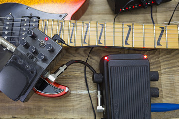 guitar fretboard and vintage effect pedals