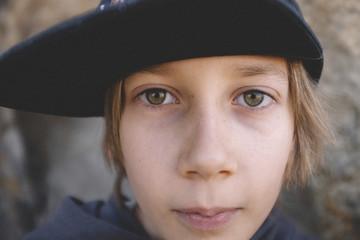 Close-up portrait of confident boy wearing cap at desert