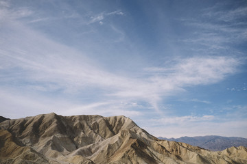 Scenic view of mountains against cloudy sky at Death Valley National Park