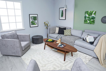 Stylish living room interior with comfortable sofa and table