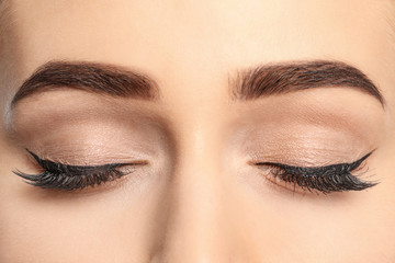 Young woman with beautiful eyebrows after correction, closeup