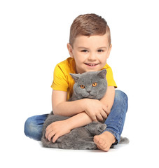 Cute little child with cat on white background