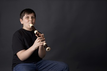 youth or young boy learns alto recorder for music class or recital.  or lessons