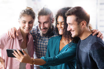 young multiethnic group of friends have fun with their selfies