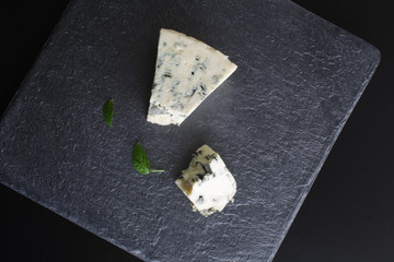 blue cheese on a stone background black