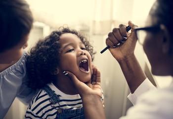 Little girl having her teeth checked