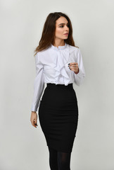 Young beautiful woman posing in new casual office cloth
