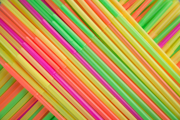 many colorful straws on table