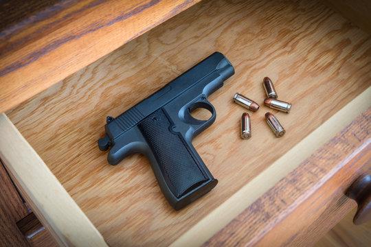 Handgun in Bedroom Dresser Drawer