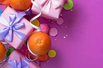 Decorative composition Three boxes with gifts Satin ribbon Bow Oranges Confetti Serpentine birthday party.