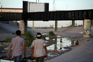 Children play at the Rio Bravo on the Mexican side of the border in Ciudad Juarez