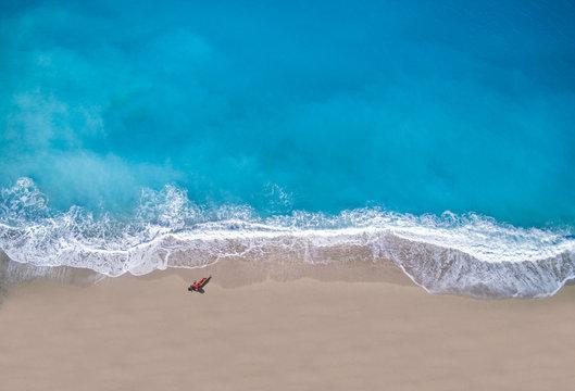 woman sunbathing lying down on the tropical beach