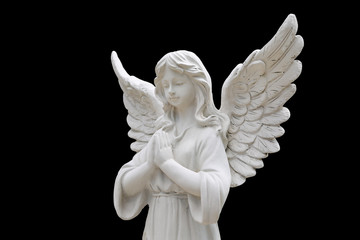 Angel statues isolated on black background.