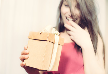 Gift box in happy woman hands