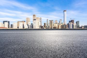 empty asphalt road with modern building