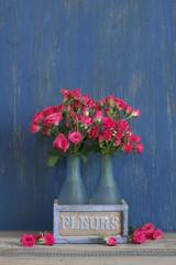 Bouquet of crimson roses on blue