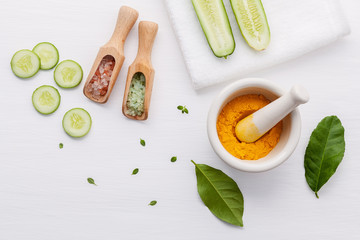 Natural herbal skin care products. Top view ingredients cucumber tumeric powder and salt on table concept of the best all natural face moisturizer. Facial treatment preparation background.