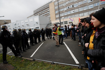Students face off with CRS riot police as they demonstrate outside the Rouen hospital ahead of French President Emmanuel Macron's visit to unveil an autism plan