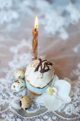 Easter cake, eggs and a candle