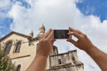 Tourist taking photo of Perigueux, France