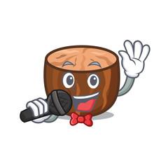 Singing nutmeg mascot cartoon style