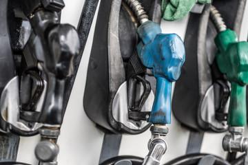 Gasoline and diesel pump nozzles in a gas station closeup. Filling gun, gas refueling nozzle, gasoline pump