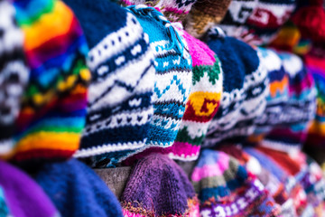 Colorful handmade knitted hats on the Nepalese market, close-up