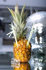 pineapple cocktail on glass table