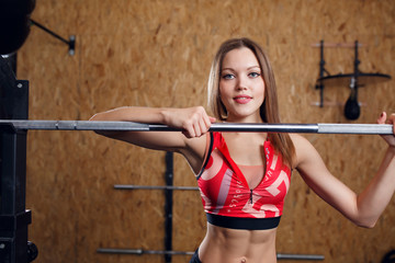 Picture of young athlete in sports clothes with barbell
