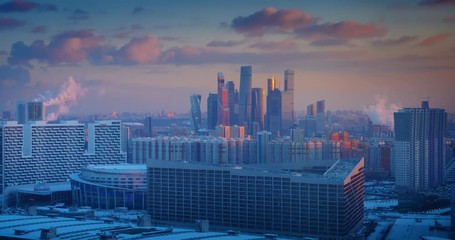 Fototapete - Moscow city skyline changing from sunset to night, zoom in on skyscrapers. Russia. 4K UHD Timelapse.