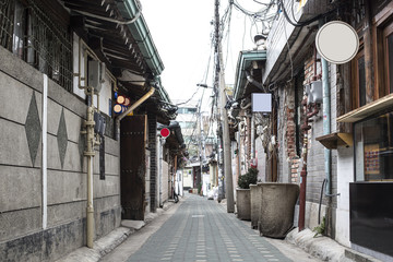 Old street alley in Seoul - Side street with old, shabby buildings, located in the old city center...