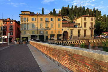 Verona, Italy - historic city center - St. Peter hill and Castel with Archeological Museum and ancient Roman Theater at Ponte Pietra bridge over Adige river