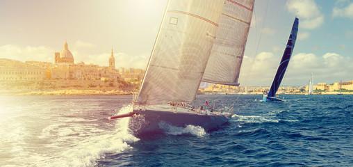 Sailing yachts and sun rays. Sailing. Yachting