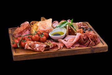 tasty plate of cheese, salami, prosciutto, cherry tomatoes over wooden board
