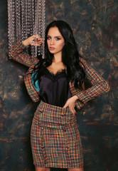 beautiful sensual woman with long dark hair in elegant clothes