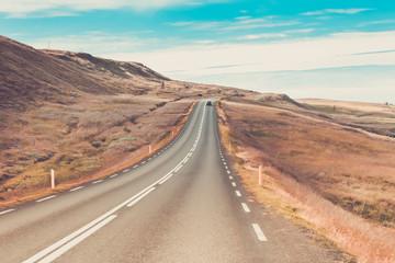 Foto op Plexiglas Zalm Highway through Icelandic landscape under a blue summer sky