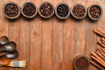 Close up of coffee beans in wooden bowl and cinnamon